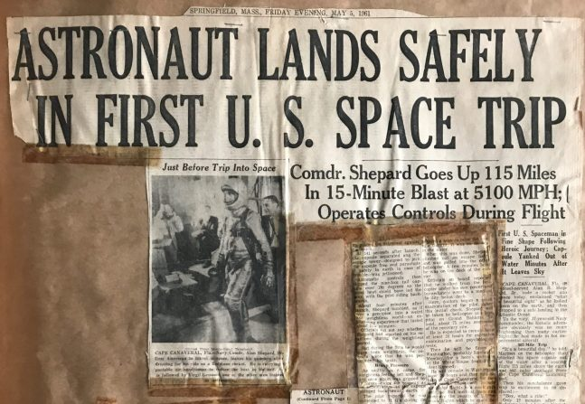 Scrapbook page with the newspaper headline Astronaut lands safely in first U.S. Space Trip