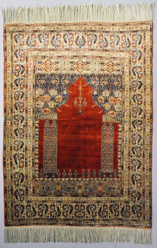 Colorful, patterned prayer rug from Iran