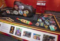 Saxophone case and concert badges in Horn Man exhibit