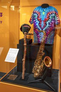 Tie dye shirt and saxophone in Horn Man exhibit