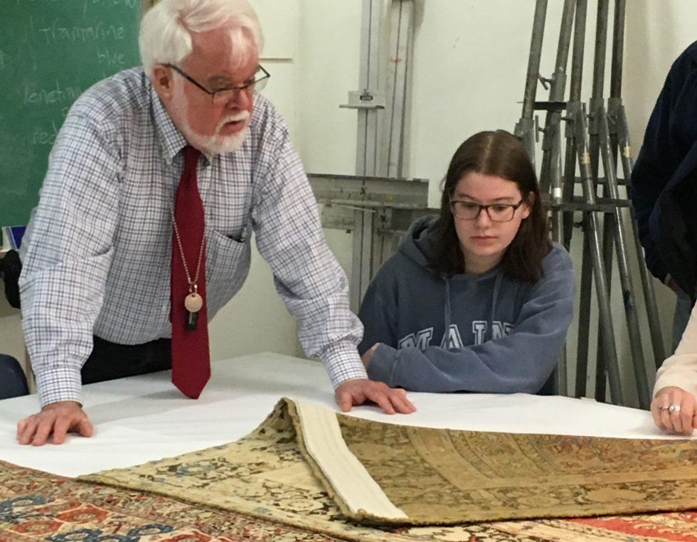 Prof. Walter Denny examines a rug