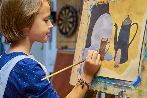 Girl painting a picture.