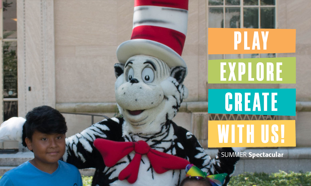 Young visitor with the Cat in the Hat costumed character