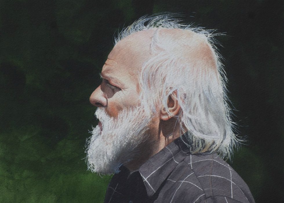 Profile portrait of a man with a white beard